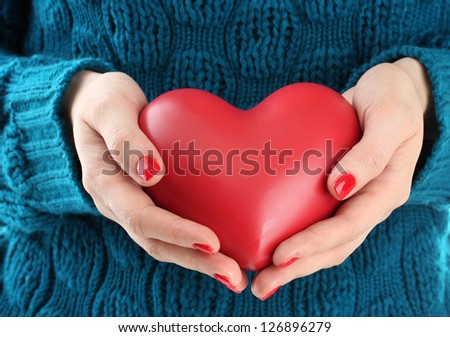 Red heart in woman hands, close up - stock photo