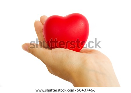 Red heart in woman's hand isolated on white