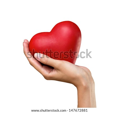 red heart in woman's hand isolated on white background - stock photo