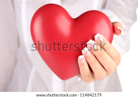 Red heart in woman's hand, on white background close-up - stock photo