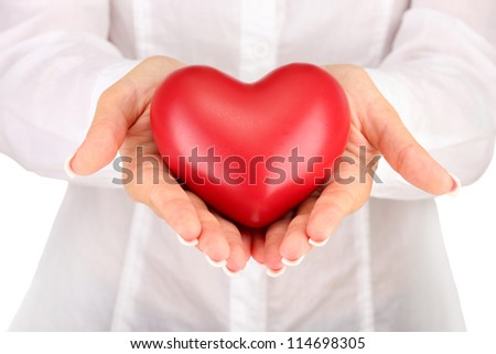 Red heart in woman's hands, on white background close-up - stock photo