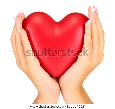Red heart in woman's hands, on white background close-up