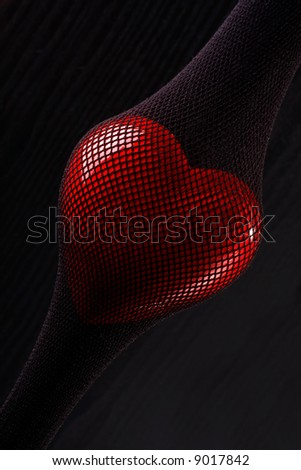 Red heart inside of the stretched stocking in a grid