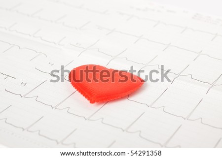 Red heart isolated on the cardiogram - stock photo