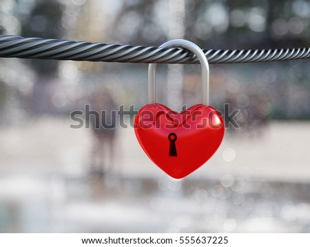 Red heart lock on nature background