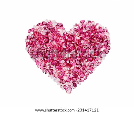 Red heart made of precious stones on white background - stock photo
