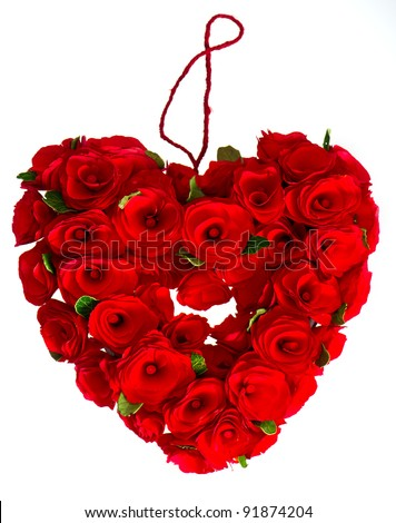 red heart of roses on white background - stock photo