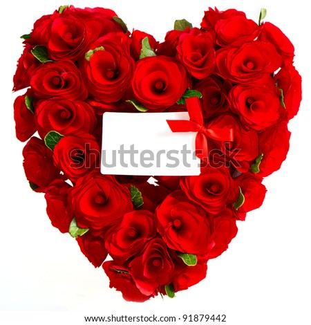 red heart of roses with white card for your text - stock photo