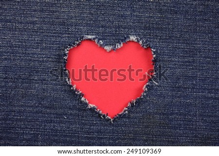 Red heart  of   torn denim jeans background :Valentine Heart Card Design - stock photo