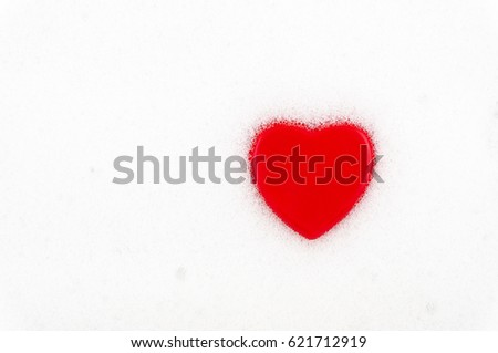 Red heart on a light background. Soap foam with heart.