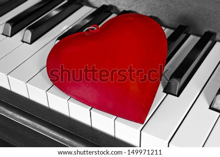 Red heart on a piano