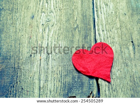 Red heart on a wooden background  - stock photo
