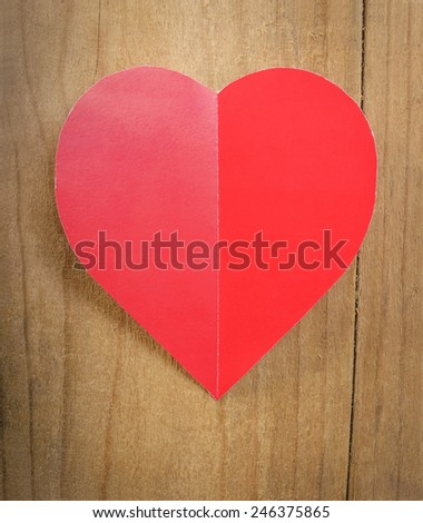 Red heart on a wooden background. Background in the style of Valentine's Day.
