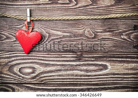 red heart on a wooden background.It can be used for congratulations valentine or mother's day - stock photo