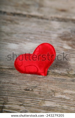 Red  heart on a wooden background. Valentines day background.