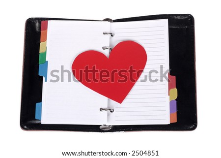 red heart on blank notepad - stock photo
