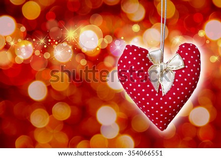 Red heart on bokeh background - stock photo