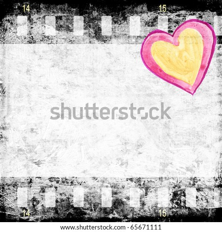 Red heart on grunge paper with film strip - stock photo