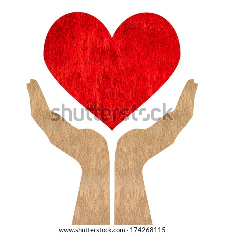 Red heart on hand made of concrete texture isolated on white background - stock photo