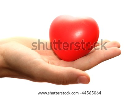 Red heart on man hand isolated on white background.