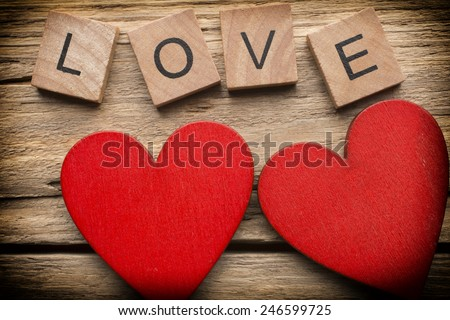 Red heart on old wooden background - Stock Image. I love you, cast out of wood kubik. - stock photo
