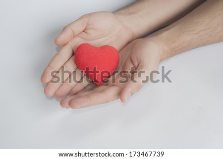 red heart on palm as a concept of giving love