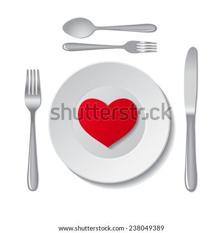 Red heart on plate on white background.