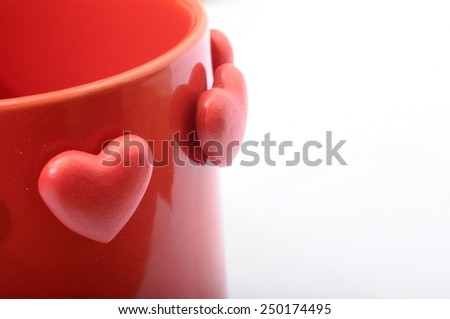 Red heart on red mug for coffee with love - stock photo