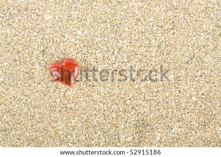 Red heart on the sand. Background - stock photo