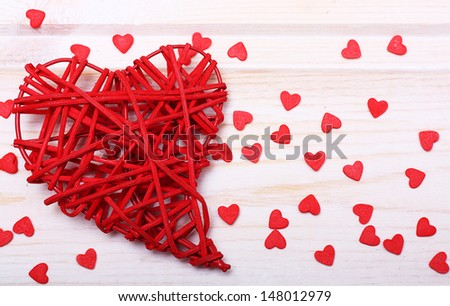 Red heart on wooden background - stock photo