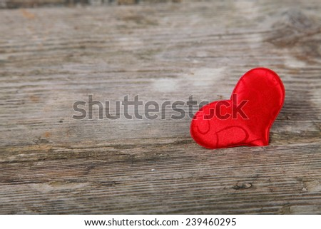 Red heart on wooden background. Valentines day background.