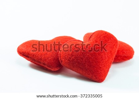 Red Heart Pillows in White Background - stock photo