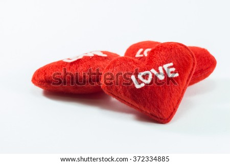 Red Heart Pillows with Word Love in White Background - stock photo