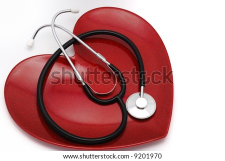 Red heart plate and stethoscope - stock photo