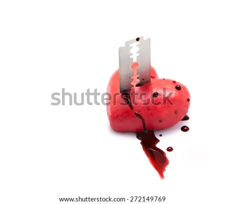 Red heart shape made by play dough stab by razor isolate on white background. concept of broken relationship. - stock photo