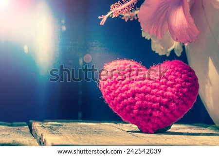 red heart shape on wooden background with light and shadow of window, abstract background to love,valentine concept. - stock photo