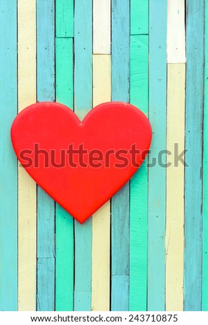 Red heart shape on wooden vintage wall