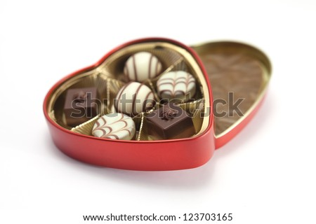 Red heart shaped box of chocolates on a white background - stock photo