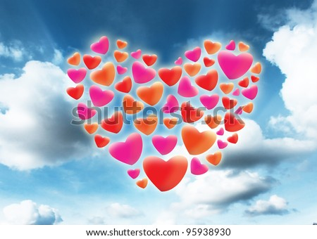 red heart shaped floating in the sky. - stock photo