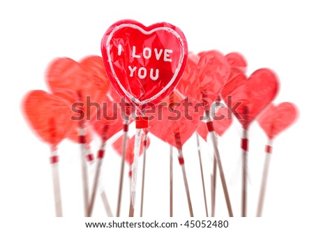 Red heart shaped lollipops over white background. - stock photo