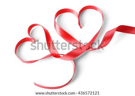 Red heart shaped ribbon isolated on white