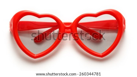 Red heart shaped sunglasses on white background - stock photo