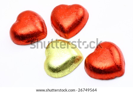 red heart shaped wrapped chocolates - stock photo