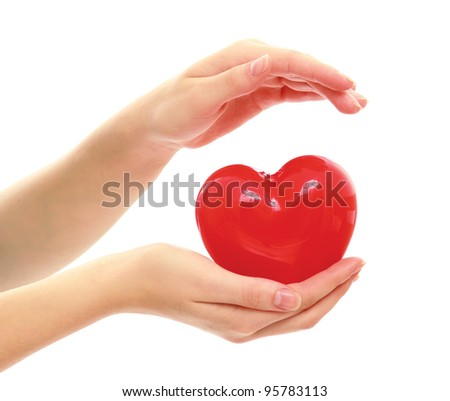 Red heart symbol in woman's hands isolated on white background