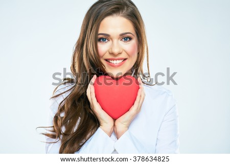 Red heart symbol of Valentines day smiling woman hold. White background isolated. - stock photo