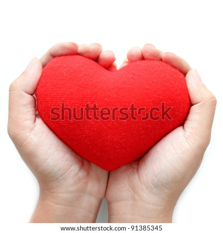Red heart symbol on hands