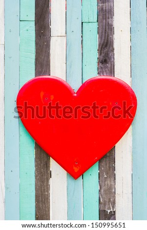 red heart symbols on wooden wall