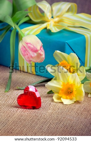 Red heart with a gift box and flowers, closeup shot, valentine's day/mother's day concept