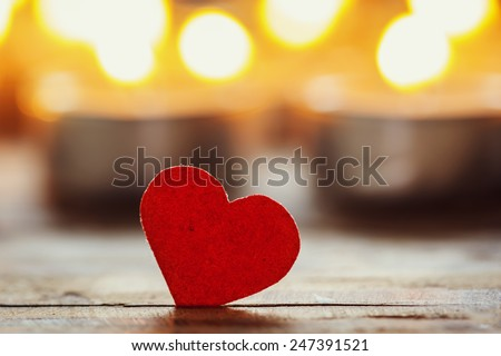 Red heart with candles on lights background, love concept, valentines day - stock photo