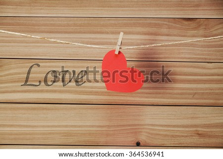 red heart with clothespin on linen rope - stock photo